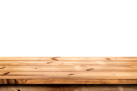 product placement: Empty wooden table for product placement or montage with focus to the table top in the foreground, with white background. Stock Photo