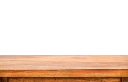 empty table: Empty wooden table for product placement or montage with focus to the table top in the foreground, with white background. Stock Photo