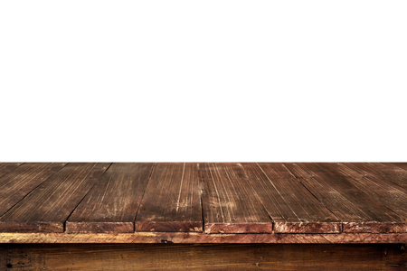 product placement: Empty old wooden table for product placement or montage with focus to the table top in the foreground, with white background.