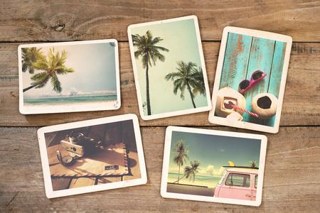tabla de surf: álbum de fotos del verano en la mesa de madera. foto instantánea de la cámara - estilo vintage y retro Foto de archivo