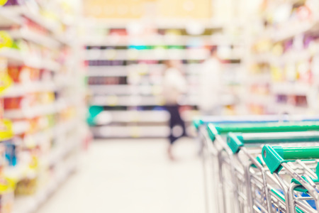 lifestyle shopping: blurred interior of supermarket - abstract background. vintage retro color filter Stock Photo