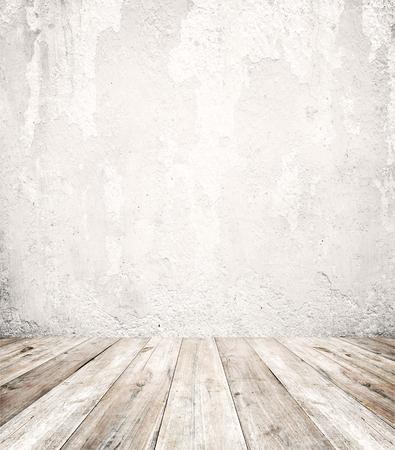 Vaciar un interior blanco de la sala de la vendimia - pared de hormigón grunge gris y piso de madera vieja. 3D realista como fondo perfecto para su concepto o proyecto. Foto de archivo