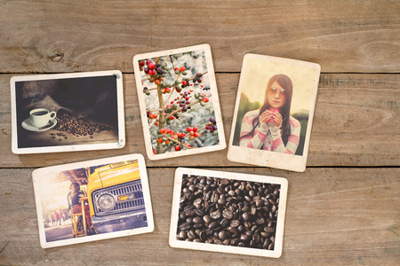 Coffee photo album on wood table. instant photo of polaroid camera - vintage and retro style