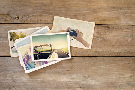 Travel photo album on wood table. instant photo of  camera - vintage and retro style