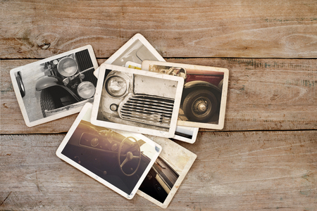 collage art: Classic car photo album on wood table. instant photo of polaroid camera - vintage and retro style
