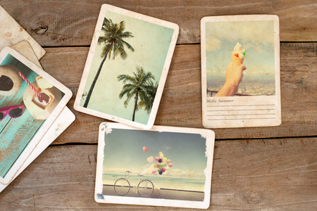 summer beach: Summer photo album on wood table. instant photo of  camera - vintage and retro style