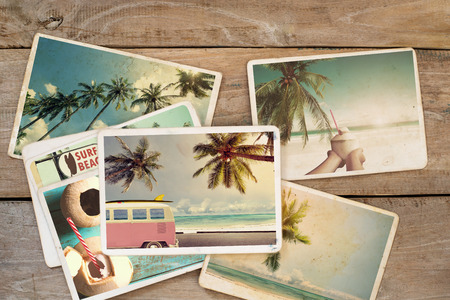 Summer photo album on wood table. instant photo of polaroid camera - vintage and retro style