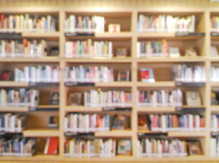 blurred bookshelf in library room for your background design Banco de Imagens