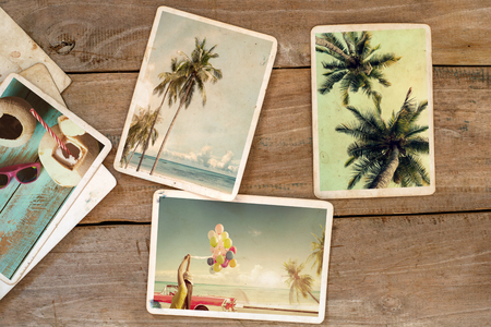 Summer photo album on wood table. instant photo of polaroid camera - vintage and retro style Imagens