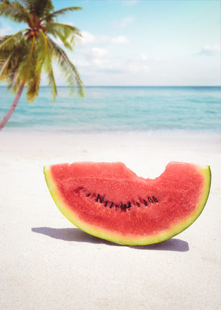summer fruit: Summer fruit concept with watermelon on sandy tropical beach