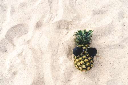 Hipster pineapple on beach - fashion in summer. vintage filter effect