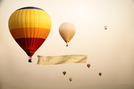 Vintage hot air balloon with blank flag for your add message - retro filter effect style