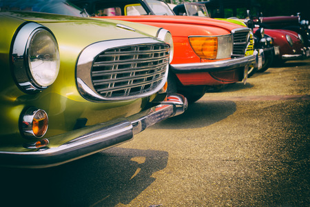 Classic cars in a row - vintage retro color effect style