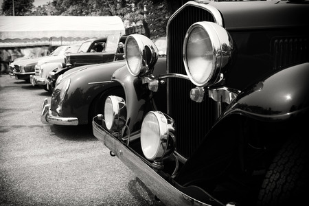 Black and white photo of classic car- vintage film grain filter effect styles Standard-Bild