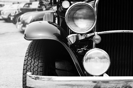 black car: Black and white photo of classic car- vintage film grain filter effect styles Stock Photo