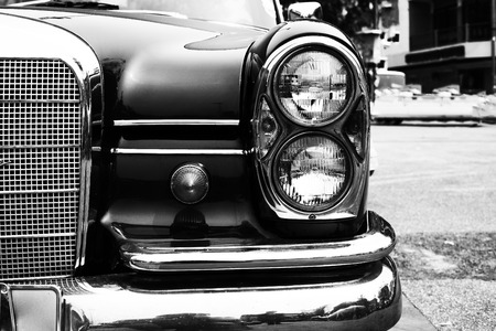 old vintage: Black and white photo of classic car- vintage film grain filter effect styles Stock Photo