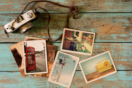 vintage photo: Retro technology instant photo album on wood table. paper photo of vintage camera - vintage and retro style