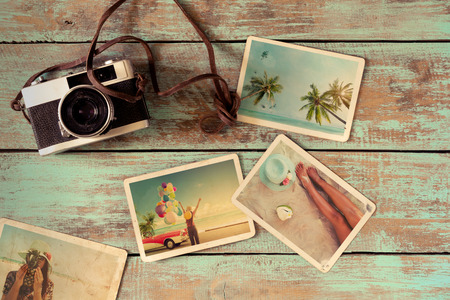 Summer photo album of journey honeymoon trip on wood table. instant photo of vintage camera - vintage and retro style Stock Photo