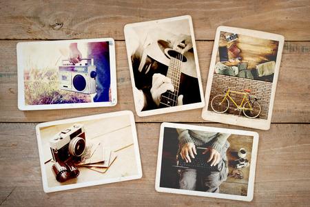 木のテーブルに夏に流行に敏感なライフ スタイル旅旅のフォト アルバム。ビンテージ カメラのインスタント写真のヴィンテージやレトロなスタイ