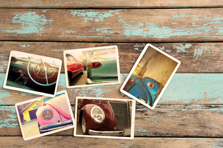 collages: Classic car photo album on wood table. instant photo of retro camera - vintage styles Stock Photo