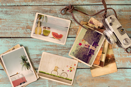 tropical border: Photo album of journey honeymoon trip in summer on wood table. instant photo of retro camera - vintage and retro style Stock Photo