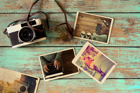 Photo album of hipster lifestyle journey trip in summer on wood table. instant photo of retro camera - vintage and retro style