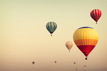 Hot air balloon on sky with fog, vintage and retro filter effect style