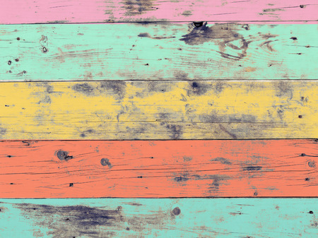 colored: The colorful artwork painted on wood material for vintage wallpaper background.