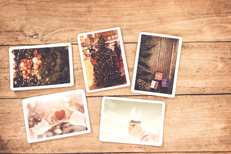 old frame: Merry christmas (xmas) photo album on old wood table. paper photo of polaroid camera - vintage and retro style
