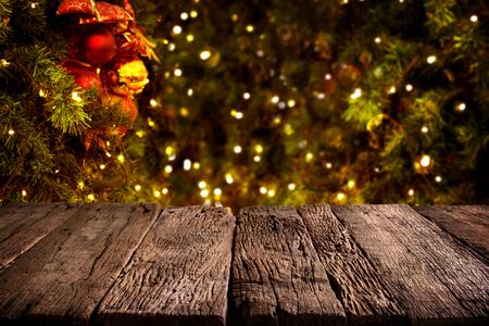 christmas lights background: Christmas tree. Blurred christmas background, lights hanging in a pine tree - vintage color tone Stock Photo