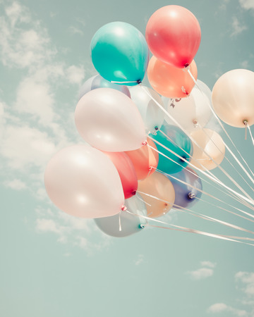 colorful balloons. happy birthday party in summer holidays - vintage pastel color styles. Stock Photo