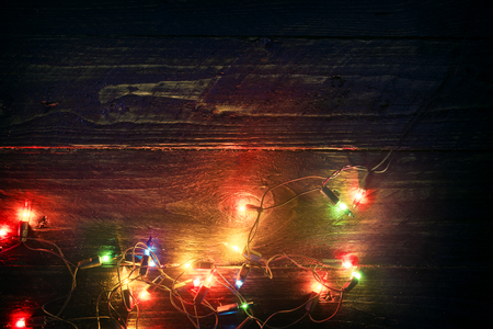 christmas lights background: Christmas lights background - Rustic Merry christmas (xmas) background with plank wood with colorful lights and free text space. vintage styles Stock Photo