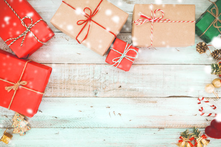 christmas present box: Christmas background - Christmas present gifts box and snow on wooden background. vintage color tone