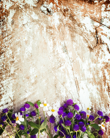 Colorful flowers bouquet on vintage wooden background. vintage color tone