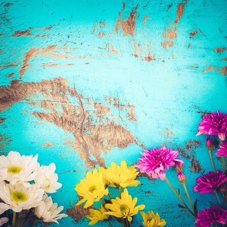 Colorful flowers bouquet on vintage wooden background, border design. vintage color tone - concept flower of spring or summer background Stok Fotoğraf - 68874534
