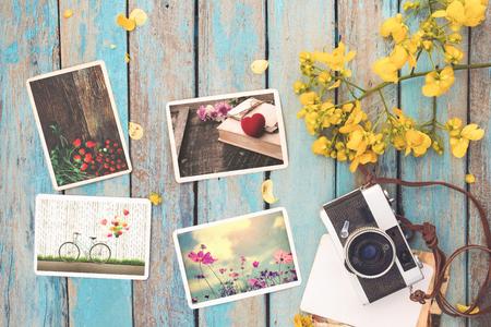 レトロなカメラとバレンタインの日 - 春の記憶と郷愁の写真の木のテーブルのインスタント紙フォト アルバム。ビンテージ スタイル 写真素材