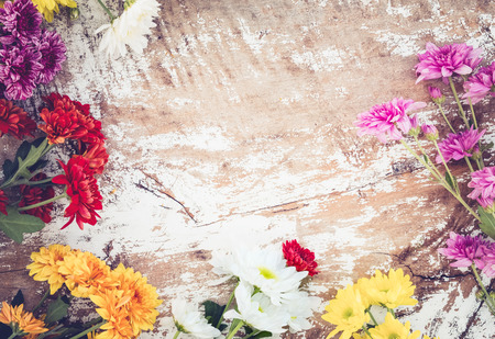 Colorful flowers bouquet on vintage wooden background, border design. vintage color tone Stok Fotoğraf - 72012431