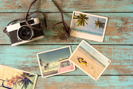 Summer photo album of journey in summer surfing beach trip on wood table. instant photo of vintage film camera - vintage and retro style