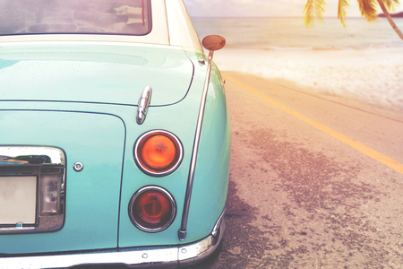 Journey of beach holiday - Rear of classic car parked side beach in summer. vintage retro color effect styles