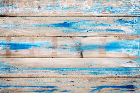 파란색 페인트 오래 된 목조 배경입니다. 여름에 해변에서 빈티지 나무 질감입니다. 스톡 콘텐츠