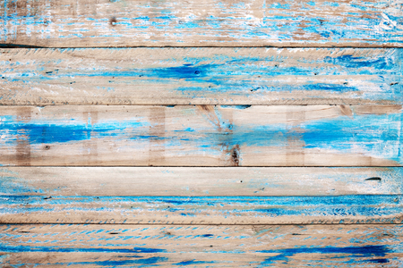 Old wooden background with blue paint. vintage wood texture from beach in summer. Standard-Bild