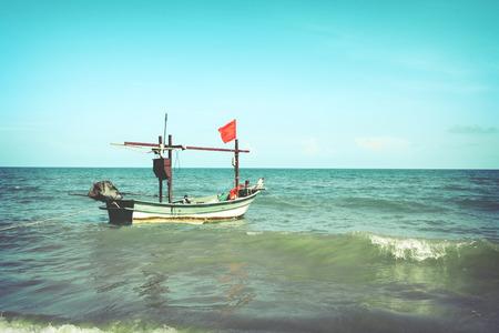 ocean fishing: Vintage fishing boat in ocean.