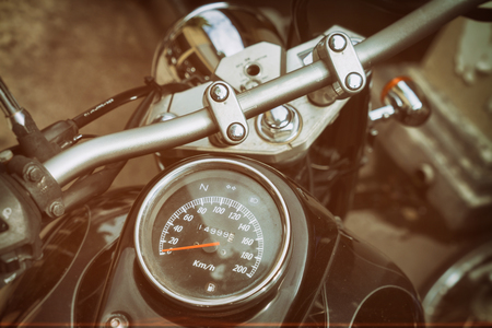 Gauges of old classic motorcycle, vintage sepia color effect
