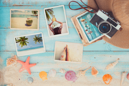 old items: Top view composition - Summer photo album with starfish, shells, coral and items on wooden table. Concept of remembrance and nostalgia in summer tourism, travel and vacation. vintage color tone.