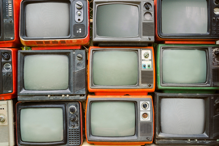 Pattern wall of pile colorful retro television (TV) - vintage filter effect style. Reklamní fotografie - 74965397