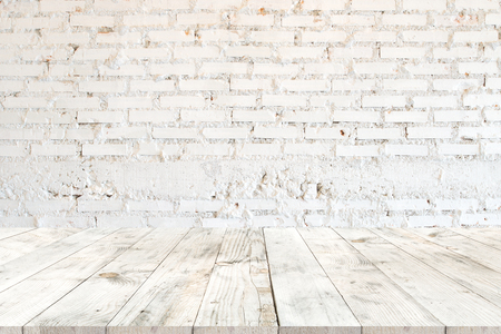 Empty clear white wood table for product placement or montage, perspective style. vintage white brick wall background.