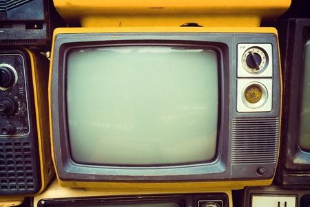 Retro old television in vintage color tone effect style. retro technology.