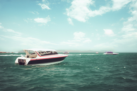 Speed boat floating in the ocean in summer. vintage effect color tone.