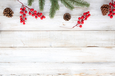 Christmas theme background with decorating elements and ornament rustic on white wood table. Creative Flat layout and top view composition with border and copy space design. Stock Photo
