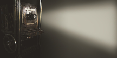 Vintage movie projector with light on gray backdrop use for background or web banner design. 免版税图像